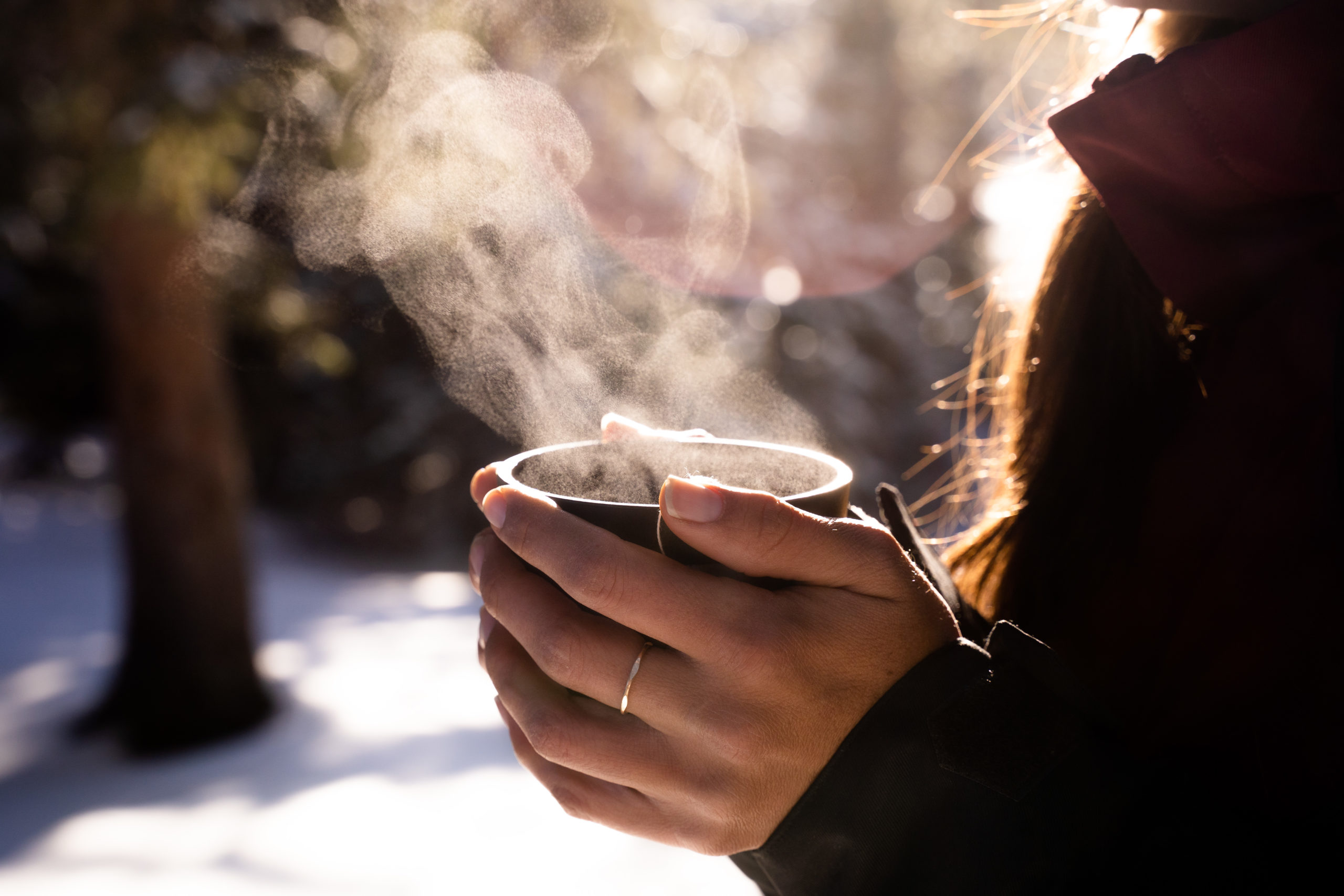 hot beverages winter drinks hands holding thermos