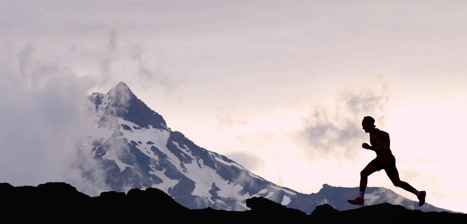 trail runner mountains snow winter